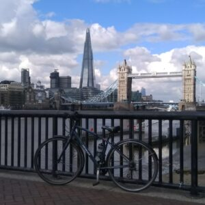 Bicycle against a railing with the Tower Bridge and the Shard on the backgroung